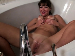American housewife Gina getting wet in the bathtub