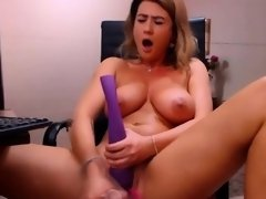 Juicy amateur camgirl with big boobs dildoing on webcam