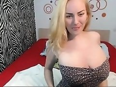 Sexy young blonde flaunts her nice cleavage and tight assho