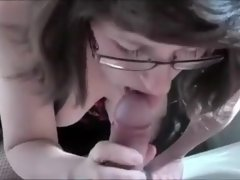 Busty mature milf with glasses enjoys cock sucking on cam