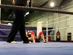 Athletic dyke dominates in a wrestling match